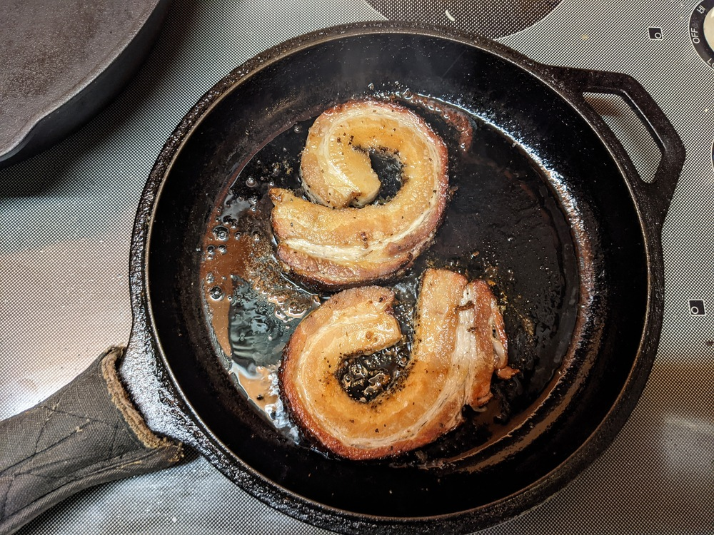 photo of frying pork belly
